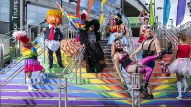 Participants in the 2021 Mardi Gras parade pose at the SCG on Friday.