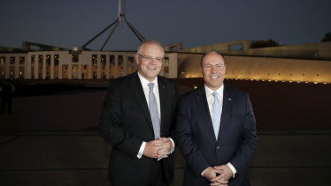 Prime Minister Scott Morrison and Treasurer Josh Frydenberg arrive for early morning interviews at Parliament House on Wednesday after delivering a budget that promised tax cuts in the years to come.