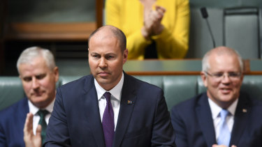 Federal Treasurer Josh Frydenberg delivers the 2019-20 budget. The Parliamentary Budget Office says longer term, the budget is on track for a $54 billion surplus.
