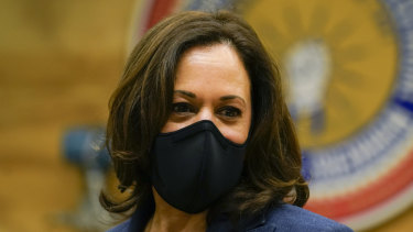 Democratic vice presidential candidate Senator Kamala Harris listens during a tour of a training facility in Milwaukee.