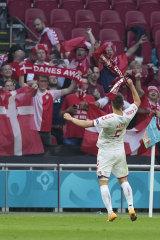 Denmark's Joakim Maehle celebrates with fans.