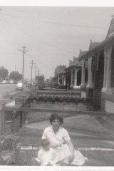 Irene and Nicholas Kotsornithis outside 10 Eurimbla Avenue, Randwick, looking south circa 1956.