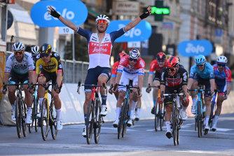 Jasper Stuyven wins Milan-San Remo ahead of Australian Caleb Ewan, right, and Wout van Aert, left.