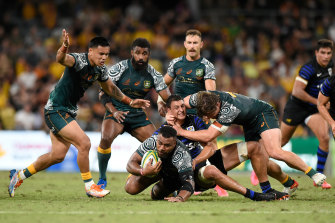 Samu Kerevi, pictured being tackled, was among the Wallabies' best on Saturday.