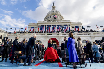 Lady Gaga arrives to perform the National Anthem as Joe Biden and Kamala Harris watch on, outside the US Capitol which was invaded by Trump supporters a fortnight ago.