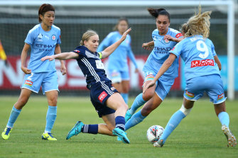 Victory's Natasha Dowie passes the ball under pressure from Melbourne City players during round five.