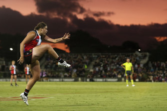 Caitlin Greiser kicks a goal for the Saints in the AFLW win over Melbourne.