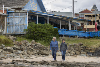 Locals Daryl Le Grew  and Penny Hawe in front of the former co-operative.