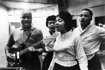 Mavis Staples (front) performing with her father and siblings circa 1970.