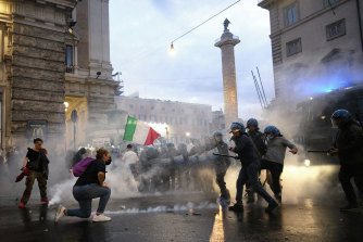 Demonstrators and police clash during the protests in Rome.