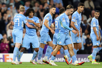 Nathan Ake (second from left) celebrates his Champions League goal on Thursday.