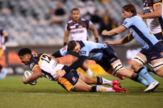 Irae Simone is tackled at GIO Stadium.