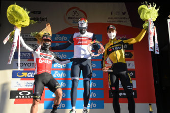 Jasper Stuyven on the podium, centre, with runner-up Caleb Ewan, left, and Wout van Aert, right, who was third.