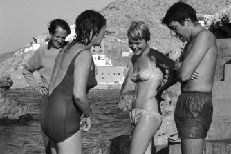 From left: George Johnston and Charmian Clift chat to Marianne Ihlen and Leonard Cohen on a Hydra beach, October 1960.