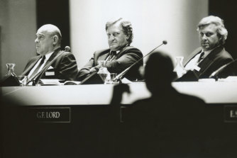 John Elliott listens as a shareholder questions the board at the Fosters annual general meeting in 1991.