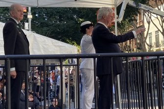 Queensland Governor, His Excellency Paul de Jersey AC takes the salute from serving men and women in Adelaide Street at the 2021 Anzac Day March in Brisbane.