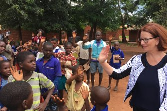 Greeting schoolchildren  in Malawi.