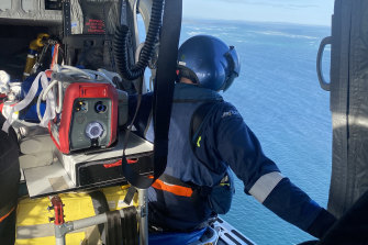 Rescue workers search for Jordan Kelly from one of eight aircraft that scoured the area off North Stradbroke Island on Sunday.