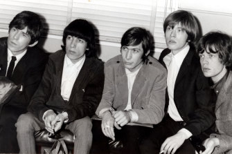 Early days: the Rolling Stones arrive in Sydney in 1965. From left, Keith Richards, Bill Wyman, Charlie Watts, Brian Jones and Mick Jagger.