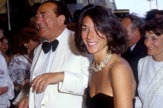 Ghislaine Maxwell, in a black dress, pictured with her father, British media tycoon and fraudster Robert Maxwell.