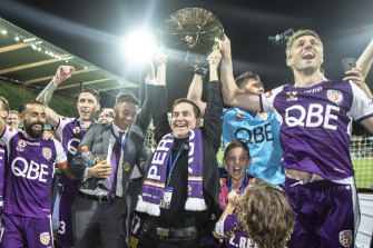 Perth Glory chairman Tony Sage, centre, celebrates the club's A-League premiership last season.