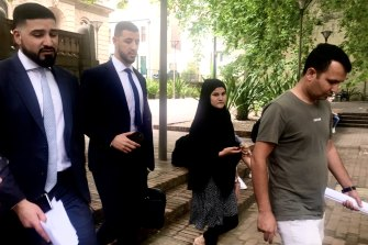 Lawyer Mahmoud Abbas (left) and family of Mehboob Shah leave court (far right).