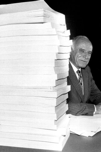Justice Robert Hope with transcripts on the final day of the royal commission into our national intelligence agencies in 1983.