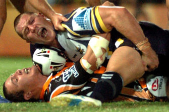 Agony: Luke O'Donnell writhes in pain after the tackle in 2007 that caused him terrible injuries.