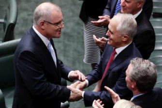 Then treasurer Scott Morrison is congratulated by Malcolm Turnbull after delivering the budget speech in 2018.
