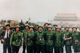 Li Xiaoming, fifth from left, in Tiananmen Square.