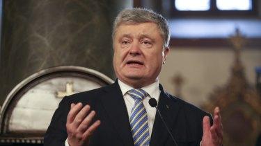 "Ukrainian President Petro Poroshenko gestures while speaking the ceremony of signing the ""Tomos"" decree of autocephaly for the Ukrainian church."