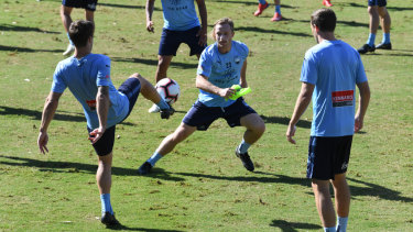 Carefree: Sydney FC were buoyant during Tuesday's training session ahead of the grand final.