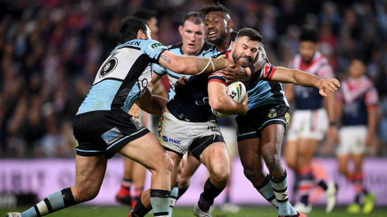 James Tedesco is tackled by Aaron Woods.