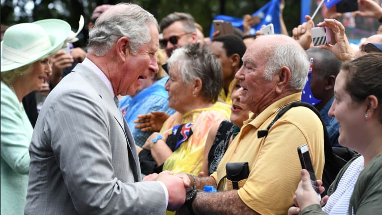 Prince Charles smiled, chatted and shook hands with many well-wishers during a public walk in Brisbane on Wednesday.