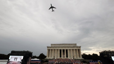 Special Air Mission 28000, Air Force One when the President is aboard, flies over Washington during an Independence Day celebration attended by President Donald Trump at the Lincoln Memorial.