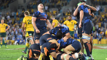 Breakthrough: Pumas players celebrate holding on for victory for the first time on Australian soil.