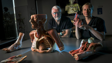 Buster, Professor Paul McMenamin and Associate Professor Michelle Lazarus.
