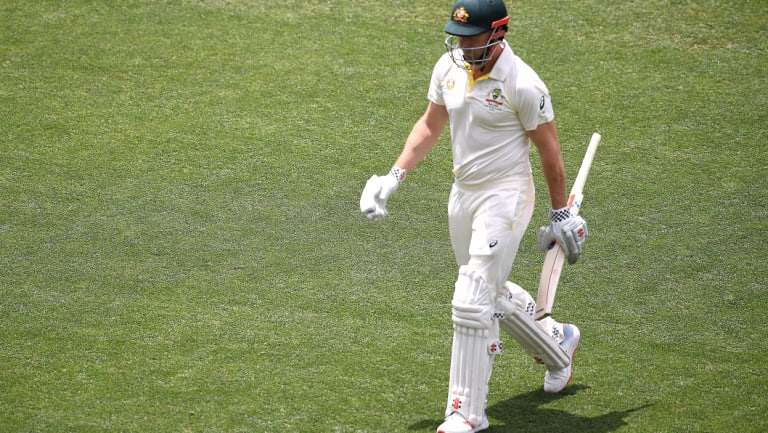 Run of outs: Shaun Marsh leaves the field after being dismissed for two in Adelaide on Friday.