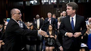 Fred Guttenberg, whose daughter Jamie was killed in a school shooting, attempts to shake hands with Brett Kavanaugh.