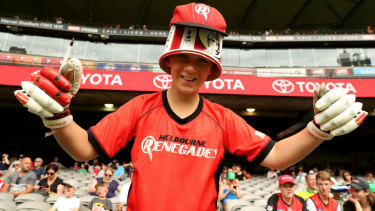 A Renegades fan supports his team wearing the traditional BBL crowd headgear.