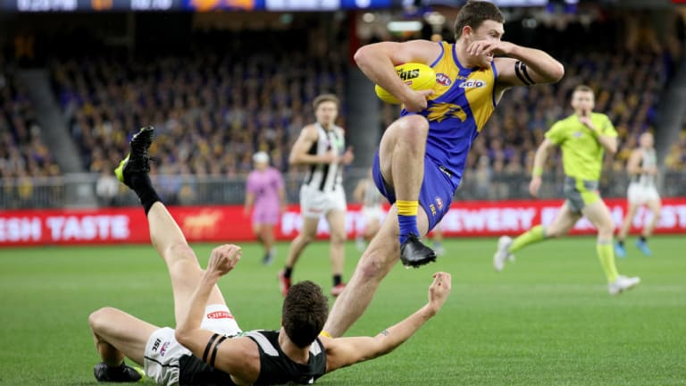 Grounded: West Coast's Jeremy McGovern gives Collingwood's Brody Mihocek the slip.