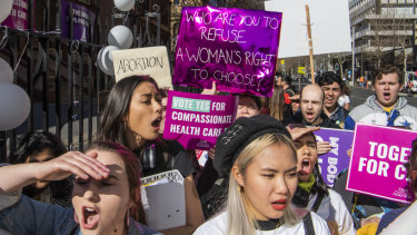 Pro-abortion protesters rally outside the NSW Parliament in Sydney as the state's Abortion Bill is debated on Tuesday.