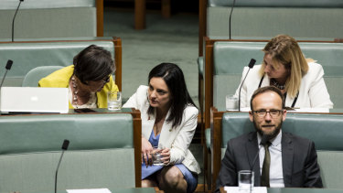 Labor MP Emma Husar speaks with independent Cathy McGowan in Question Time last week.