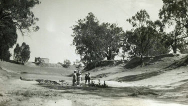 Roy Smith, his wife Nel and their son Barrie are among those standing in the Darling River bed at Balcatherine Station, c.1945. Balcatherine has been in the Smith family for five generations.