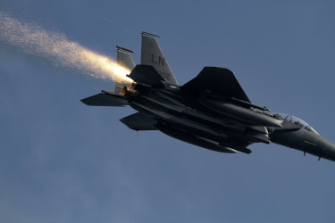This photo made available by Ian Simpson on Friday July 23, 2021, shows a shower of sparks from an F-15E Strike Eagle that experienced a malfunction after takeoff, near RAF Lakenheath, Lakenheath, England, on July 13, 2021. Photographer Ian Simpson was honored by the 48th Fighter Wing for alerting Lakenheath about the troubles when he realized the pilot wasn't aware of the issue. (Ian Simpson via AP)
