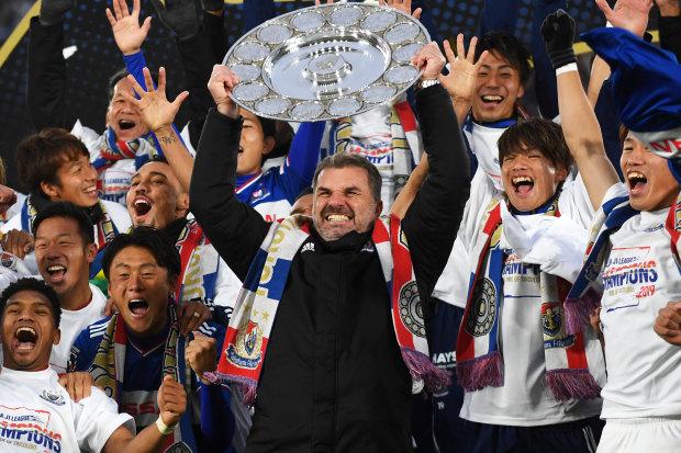 Ange Postecoglou raises the J.League trophy in triumph in Yokohama.