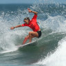 Tim Winton likens writing to surfing : here Sally Fitzgibbons rides the wave.