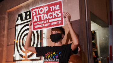 Supporters and media workers protest outside the main office of ABS-CBN on Tuesday evening.