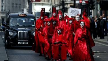 Members of Red Brigade march from Oxford Circus to Piccadilly Circus in London on Wednesday.