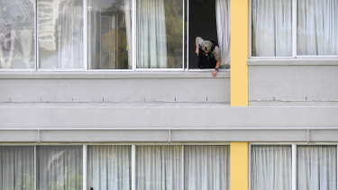 A police SERT officer at the Chasely Apartments Hotel, where two men were holed up in an apartment below.